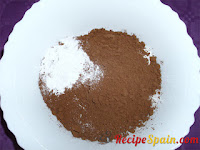 Cocoa powder in a bowl with other ingredients