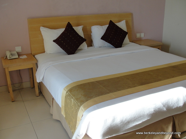 guest room bed at the Laprima Hotel on Flores Island, Indonesia