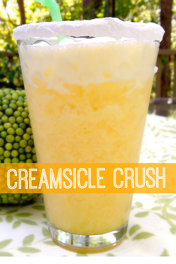 Creamsicle Crush | Whipped cream vodka, orange juice and a splash of cream served over crushed ice in a powdered sugar-rimmed glass.