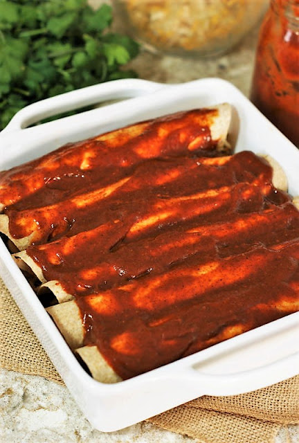 Smothering Simple Chicken Enchiladas with Homemade Enchilada Sauce Image