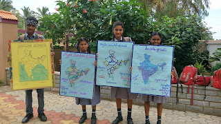 Abishek, Elizabeth, Mounika and Roshini showing off their School projects