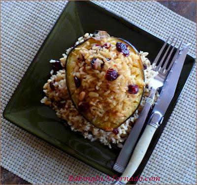 Brown Rice Stuffed Maple Acorn Squash: A beautiful fall squash, maple flavored, stuffed with brown rice, pignolis and cranraisins | Recipe developed by www.BakingInATornado.com | #recipe #dinner #holiday