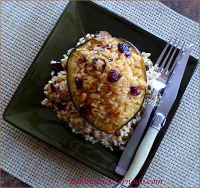 Brown Rice Stuffed Maple Acorn Squash: A beautiful fall squash, maple flavored, stuffed with brown rice, pignolis and cranraisins | Recipe developed by www.BakingInATornado.com | #recipe #dinner #holiday