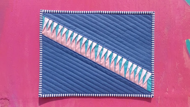 Louvered mini quilt with twisted strips for texture