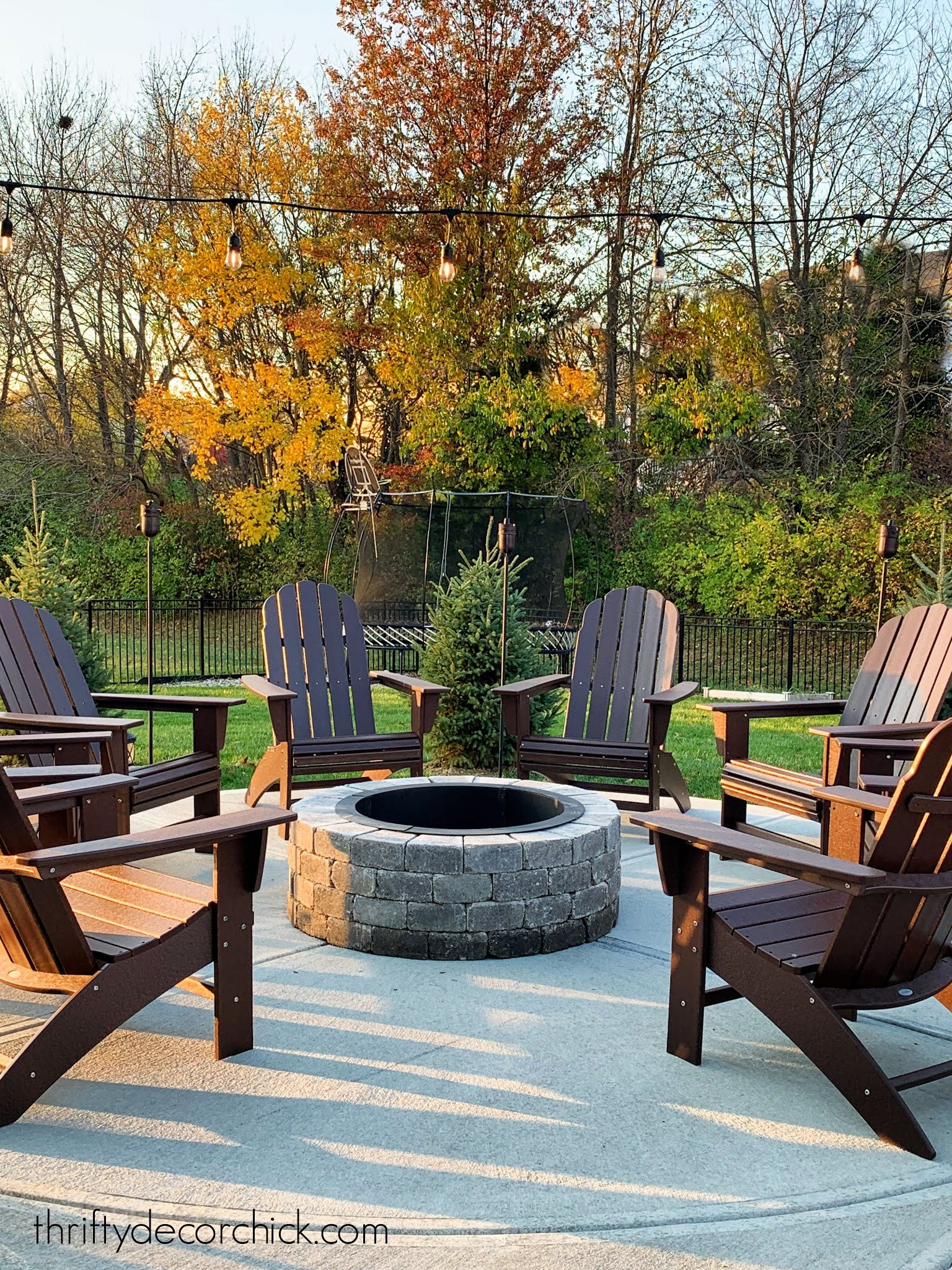 our cozy round patio fire pit with new