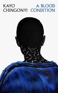 Back view of a person in a blue coat with writing on their neck