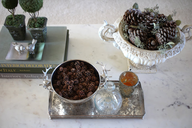 styling a coffee table fall christmas silver tray deer bowl pinecones