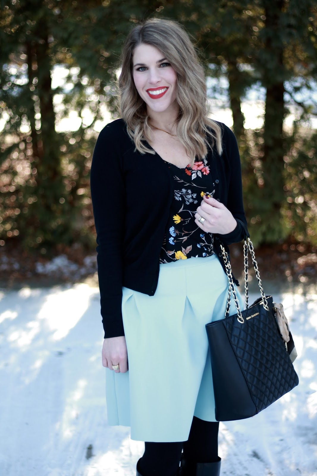 black floral blouse, black cardigan, light blue scuba skirt, black boots