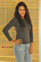 Actress Bhanu Tripathri Pos in Ripped Jeans at Iddari Madhya 18 Movie Pressmeet  0035.JPG