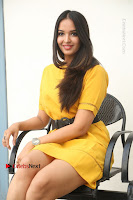 Actress Poojitha Stills in Yellow Short Dress at Darshakudu Movie Teaser Launch .COM 0256.JPG