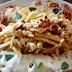 Um prato criativo e interessante que serve bem tanto como petisco como refeição, além da ótima preparação e sabores... comendo Dona Fritas e seus Dois Filés em Bar Do Celso.