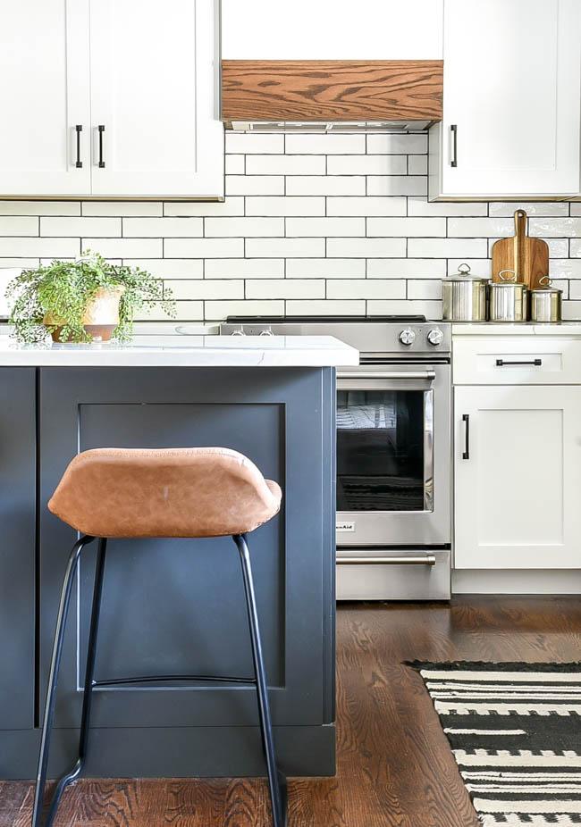 White kitchen with dark gray island