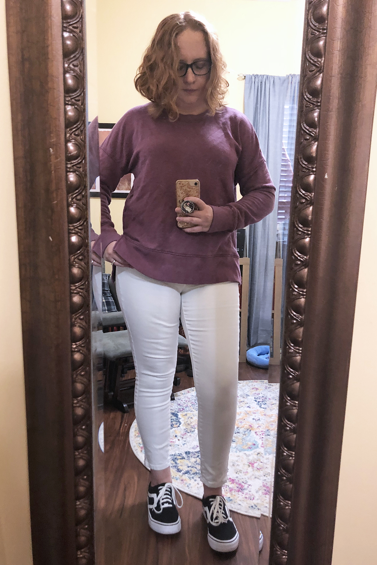 white jeans purple sweatshirt