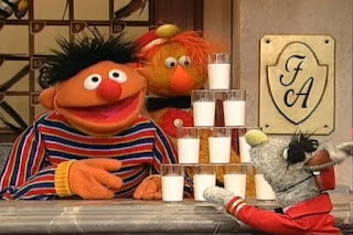 Ernie and the Dinger dings 10 times and Benny brings 10 glasses of milk. Sesame Street 123 Count with Me