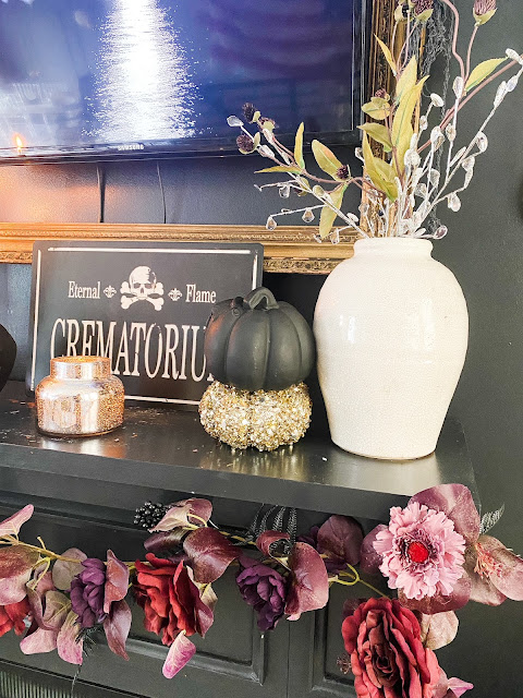 Black fireplace with glam halloween decor