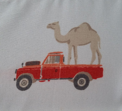 sheets with pictures of camels riding in pickup trucks