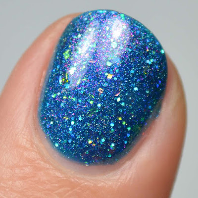 blue linear holographic nail polish with flakies swatch