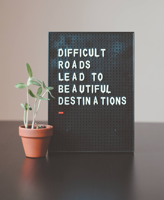 quote board next to a plant