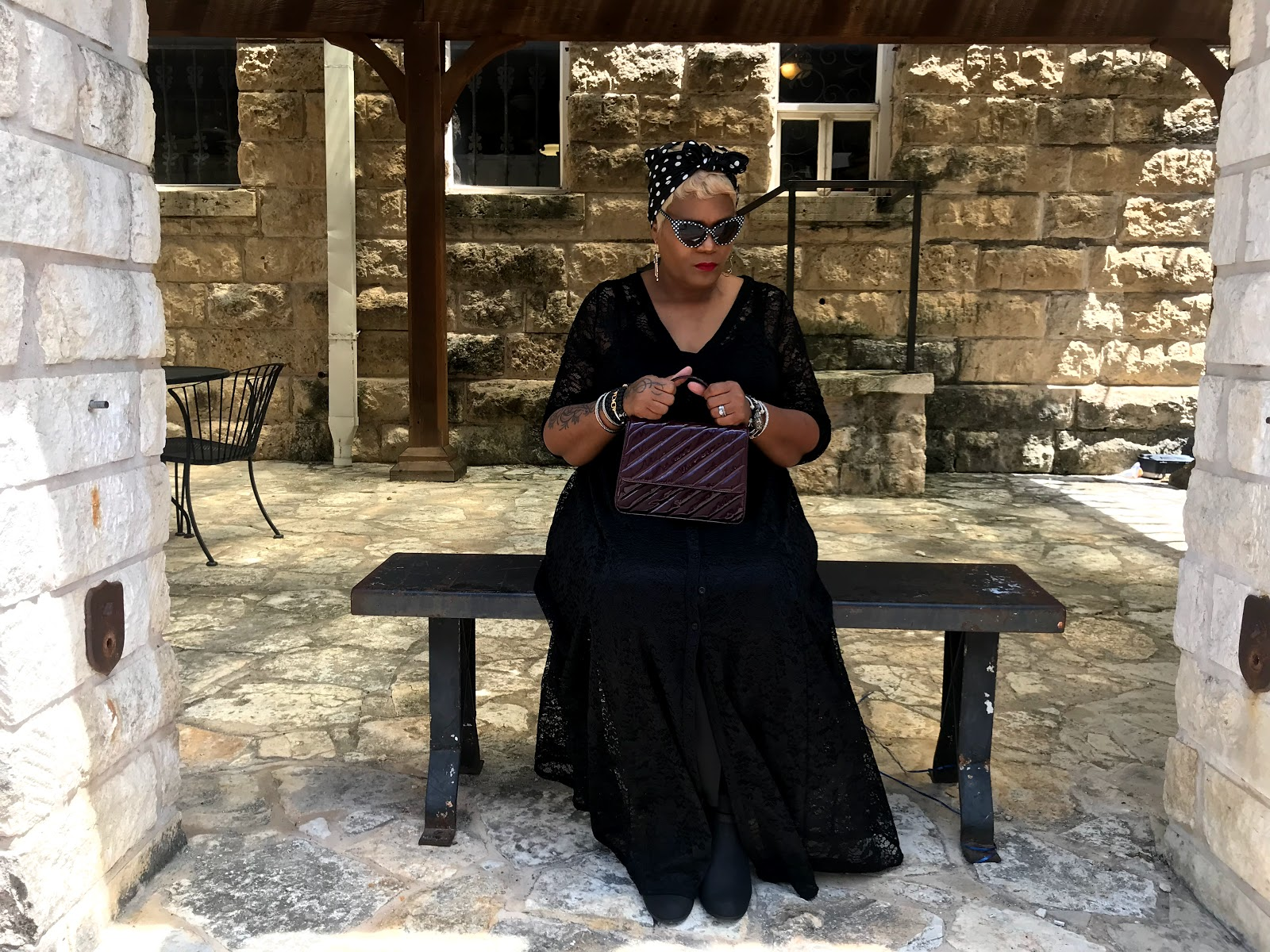 Image: Tangie Bell sitting outside in black dress, polka dot scarf, and sharing her story about midlife crying. I Thought Jada Pinkett Smith Was Lying About Crying 45 Days Until It Happened To Me! #beingfortysomething