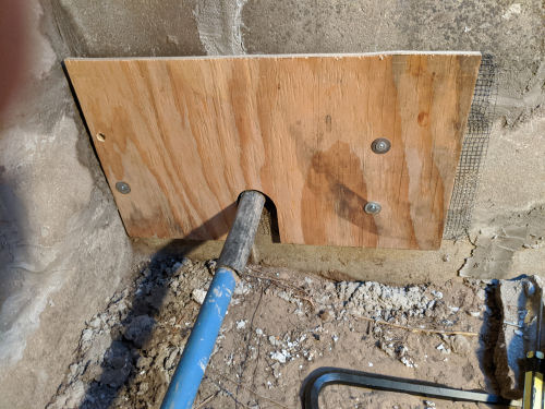 wood partition over an opening in a well pit