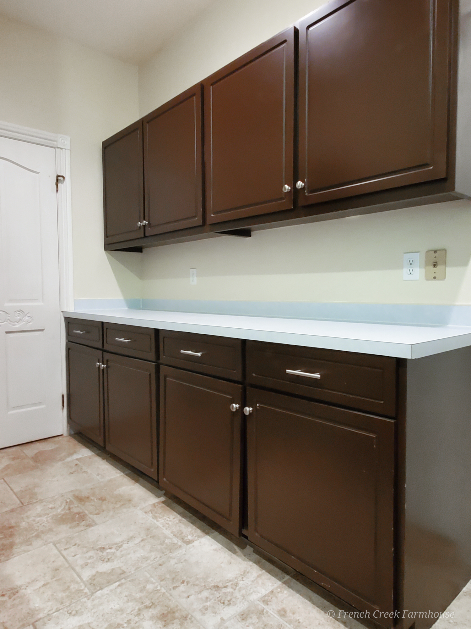 Before: Our plain brown cabinets and laminate countertops