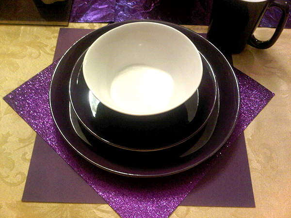 purple scrapbook papers, purple plate, saucer, bowl and mug.