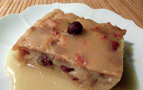 Square of Bread Pudding Swimming in Bourbon Sauce