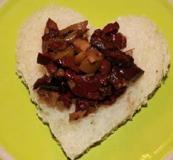 This is heart shaped bread with a 3 olive tapenade on top