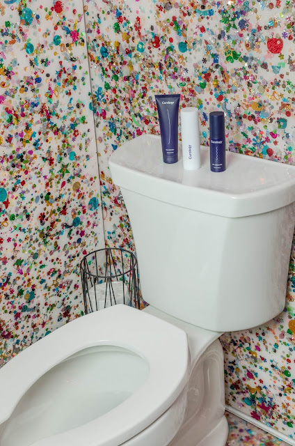 White toilet set and colorful glitter walls
