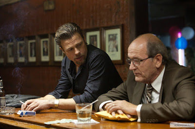 America is not a country. It s just a business : Layers of Venality in Killing Them Softly (2012)