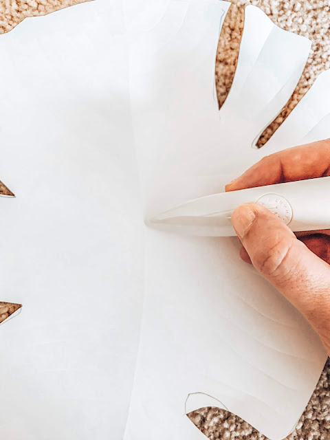 Using a bone folder to create realistic texture on paper leaves
