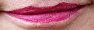 It looks burgundy in the tube but on over 40s blogger Gail Hanlon this Bourjois Rouge Velvet Edition lipstick was a deep berry shade
