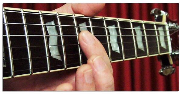 Cómo Hacer Armónicos en Guitarra
