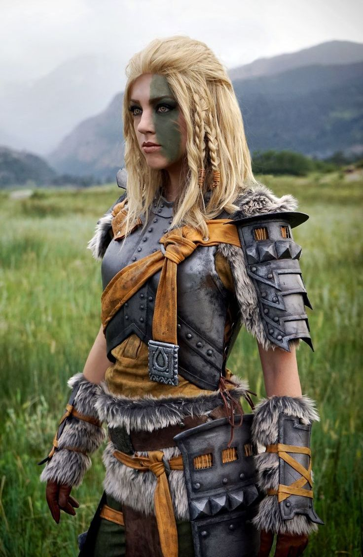 Portrait Of Blonde Viking Warrior Female Holding A Sword