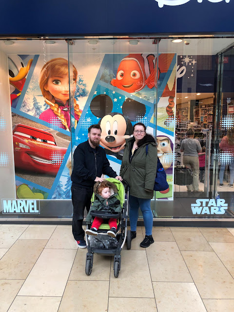 Us outside of Disney Store in Cambridge