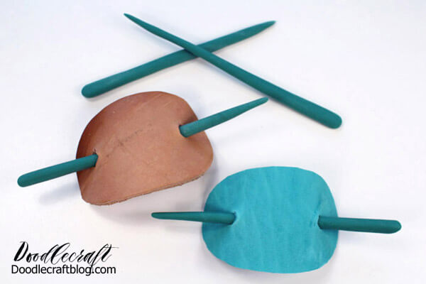 That's it! These fun leather stick barrettes will look fabulous around a ponytail. The two separate sticks are perfect for sticking in the top of a bun.
