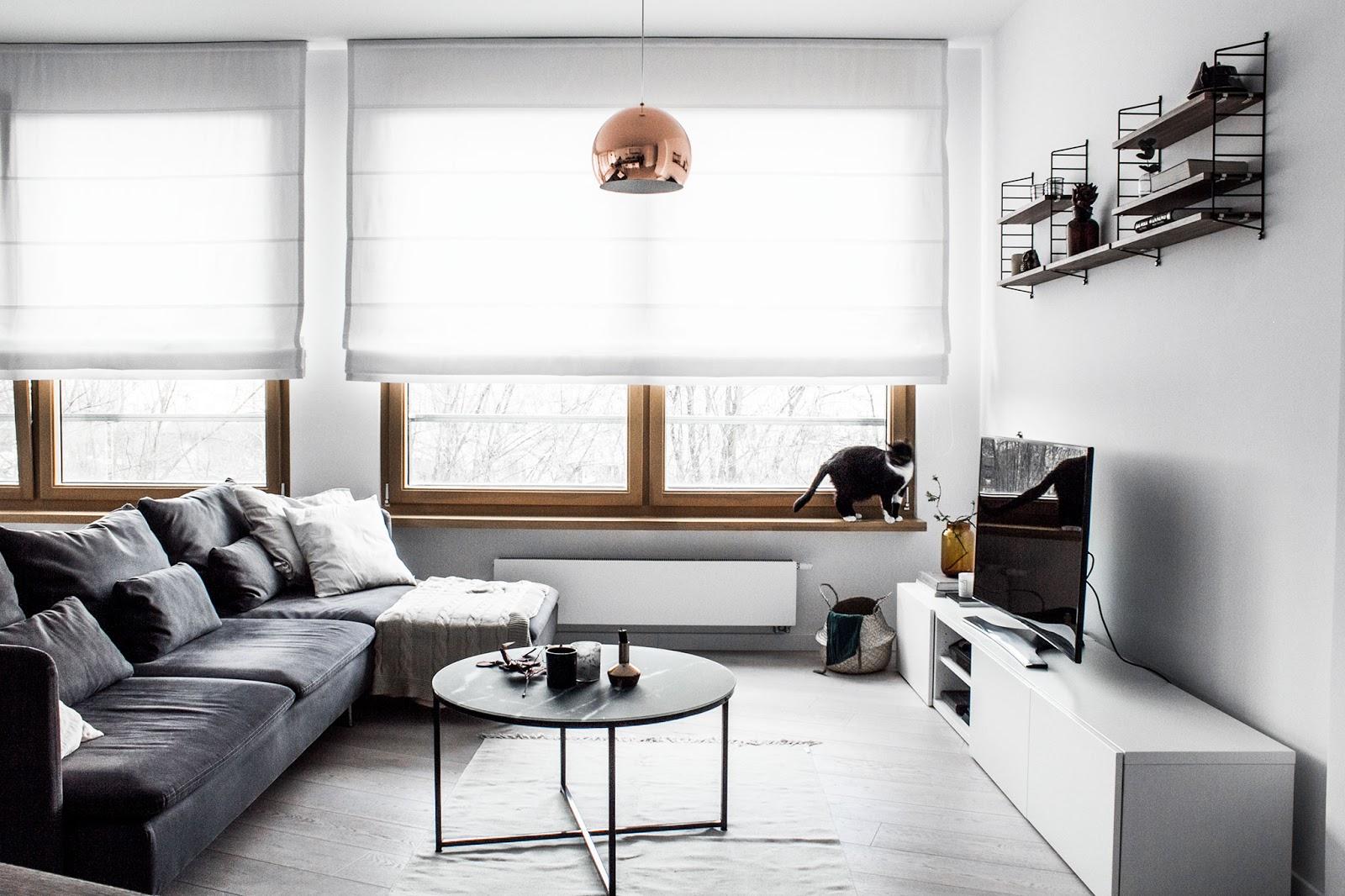 scandinavian interior design, gray sofa,