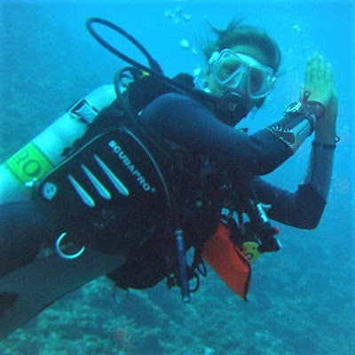 Photo of Ellis working as a scuba dive instructor on the Maldives