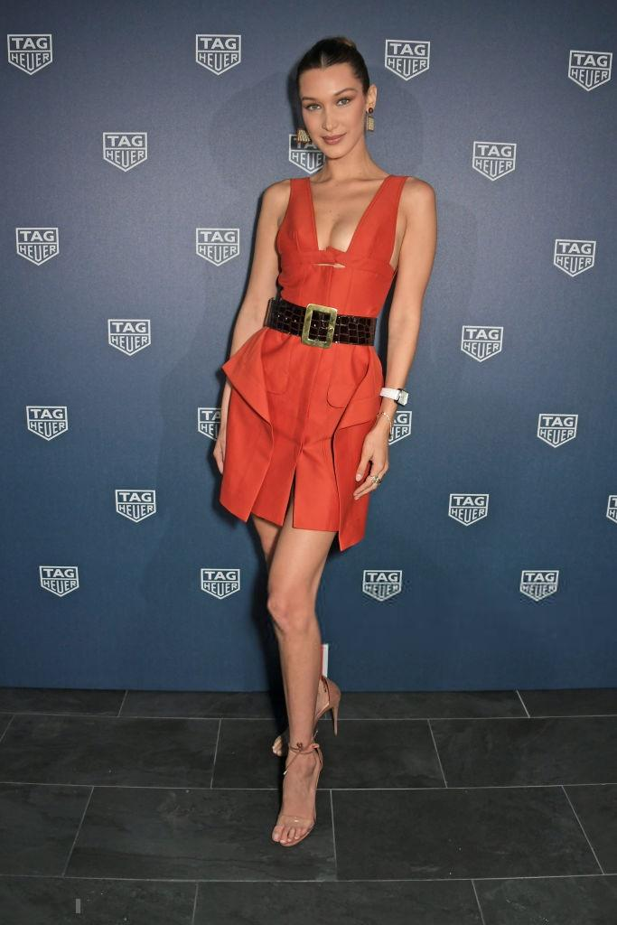 Bella Hadid shows off her toned figure in stylish burnt orange mini dress during an intimate dinner hosted by Tag Heuer in Monaco