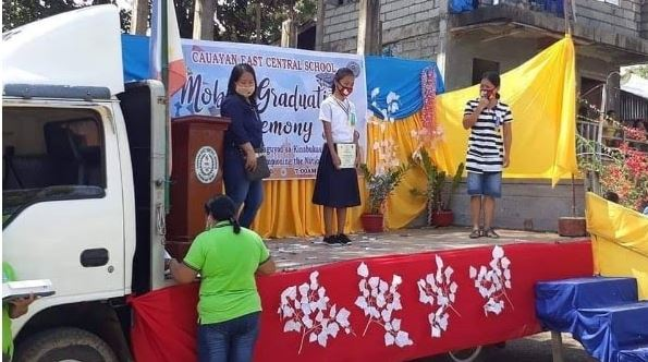 School conducts house-to-house mobile graduation ceremony