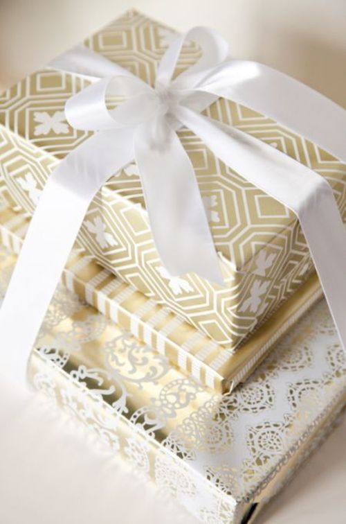 white and gold Christmas gift wrapping