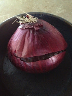 medium sized red onion in bowl