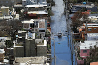 A 2013 report by the Puerto Rico Climate Change Council spelled out many of the territory's climate vulnerabilities, including urban flood risks that can spread diseases. (Credit: Joe Raedel/Getty Images) Click to Enlarge.