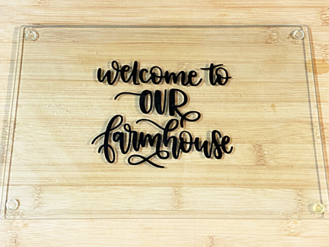 glass cutting board with farmhouse saying