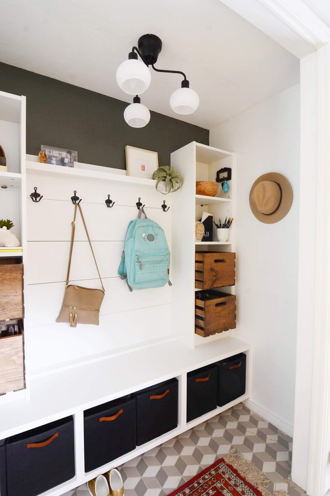 We've lived in our house a whole year!! Check out the tour and a round up of projects I've done. It's been great! | House Homemade Ikea billy bookcase mudroom