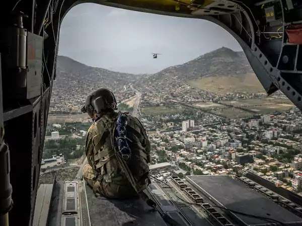 A U.S. soldier aboard a Chinook helicopter over Kabul, Afghanistan, on Sunday, May 2, 2021