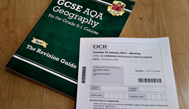 A geography revision book and an exam paper