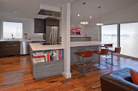 Simple timeless kitchen style ideas with white countertops and red bar stools on wooden floor