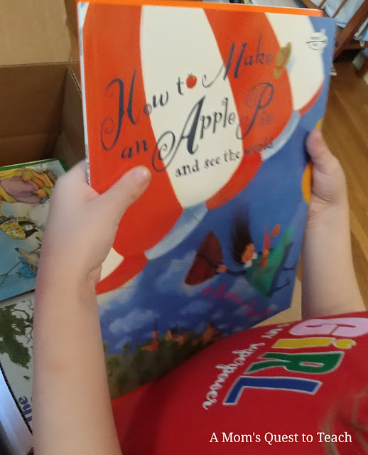 opening box of books; How to Make an Apple Pie and see the world