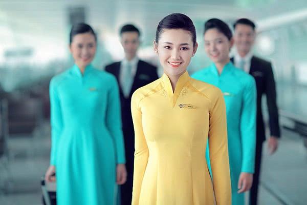 Đồng phục áo dài tiếp viên hàng không màu vàng vietnam airline